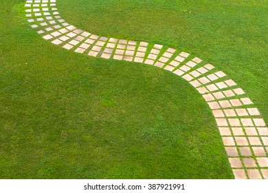 Green background with a lawn and a path