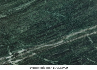 Green background, malachite deep green natural marble texture, detailed close up texture with amazing white geode in high resolution, macro photo of green natural malachite marble