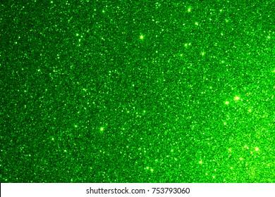 Green background texture. Glitter Christmas green
