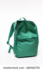 Green backpack on white background, top compartment open