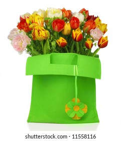 green bag with beautiful tulip bouquet and with flower deco. isolated on white background