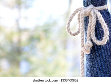 Green bag tied with coarse linen rope, free space for text
