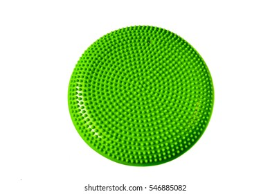 Green balance cushion for fitness and rehabilitation isolated on white background