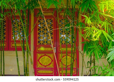 Green bamboo with blur architecture door chinese style background.