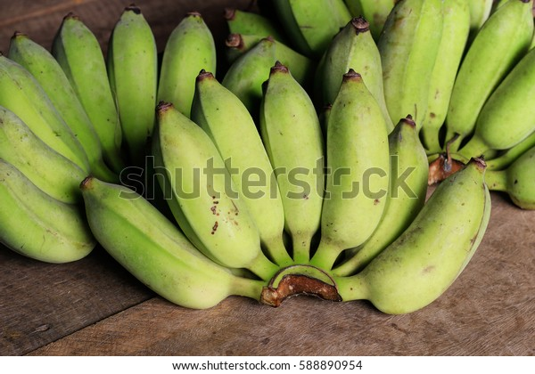 green banana bundle on wooden background