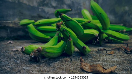 Green Bananas on the ground