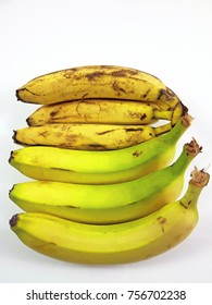 Green bananas and yellow bananas in white backgroung , Healty concept.