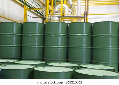 Green barrels or chemical drums stacked up