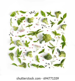 Green basil leaves and broccoli on white background. Vegetables pattern. Floral and vegetables on white background. Top view, flat lay.