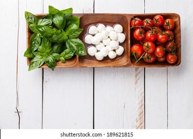 Green basil, white mozzarella, red tomatoes - Italian flag colors