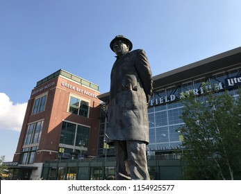 Green Bay, Wisconsin. August 9th, 2018. View of the exterior of the Green Bay Packers stadium called Lambeau Field  and the Vince Lombardi statue near it.