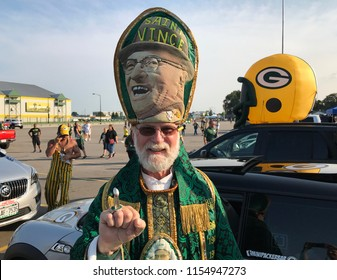 Green Bay, Wisconsin. August 9th, 2018.  The famous Packer fan known as St. Vince poses in the parking lot at Lambeau Field. His look is based on legendary coach Vince Lombardi and the Pope.