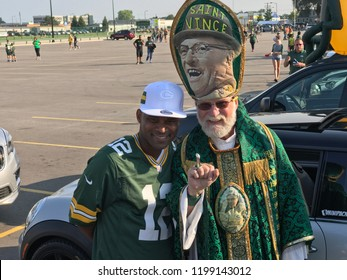Green Bay, Wisconsin. August 9th, 2018. The famous Packer fan known as St. Vince poses in the parking lot at Lambeau Field with a Packers fan before a game.