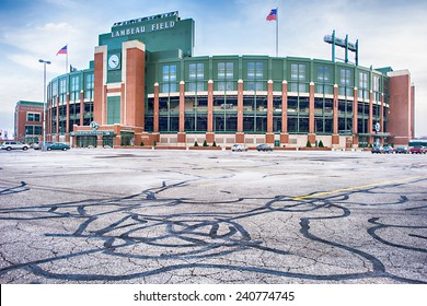 Green Bay, Wisconsin - December 2, 2014: Lambeau Field home of the Green Bay Packers with an empty parking lot except for visitors.