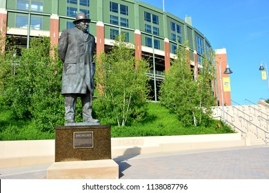 Green Bay, Wisconsin / USA - July 19, 2018: A landscape view of Lambeau Field with the bronze of Coach Vince Lombardi on the left side of the image.