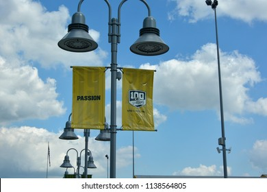 Green Bay, Wisconsin / USA - July 18, 2018:  Green Bay Packers 100 Seasons and Counting flags are out in front of the stadium.
