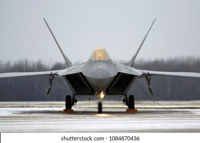 GREEN BAY, WISCONSIN / USA - November 16, 2014: Lockheed Martin F-22 Raptors prepare to perform the flyover at a Green Bay Packers home game.