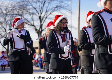 Green Bay, Wisconsin / USA - November 23rd, 2019: Green Bay East High School Red Devils musical marching band marched in 36th Annual Prevea Green Bay Holiday Parade hosted by Downtown Green Bay.