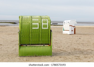 green beach chair on the North Sea beach in Germany