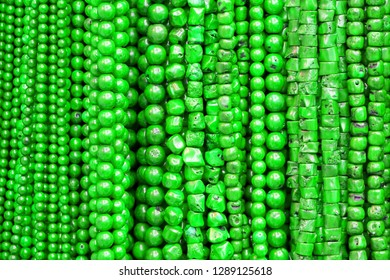 Green Beads Background. Background pattern of green natural stone beads. String of beads in various colors. Greenl beads necklaces. Handicraft fashionable for women