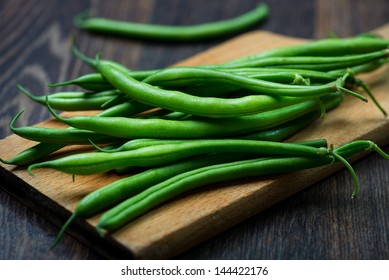 green bean on wooden plank