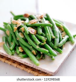 Green beans with almonds close up photo