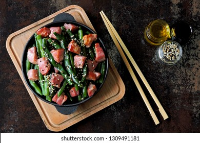 Green beans with bacon in a cast iron skillet. Healthy eating concept. Keto diet. Pegan diet. Paleo diet.