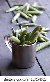 green beans in the metal mug.