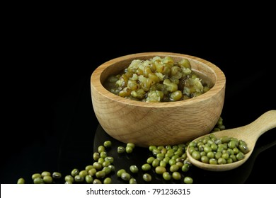 Green beans (Mung beans) in syrup, mung beans boiled with sugar in wooden cup on black background.
