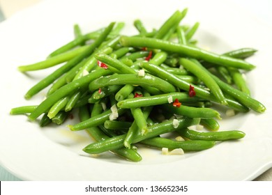 green beans on white plate
