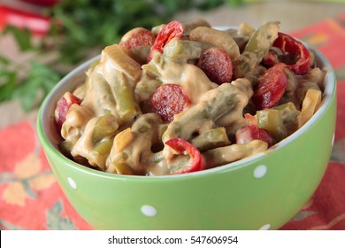 Green beans, stewed in cream sauce with sausage and chili