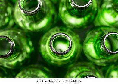 Green beer bottles shot from above close up