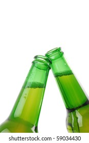 Green beer bottles with water drops on white