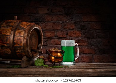 Green beer, shamrock and coins on wooden table, St Patrick's day concept