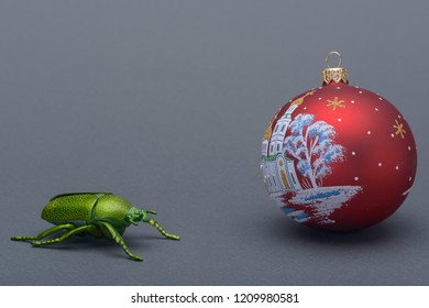 a green beetle and new year's eve ball