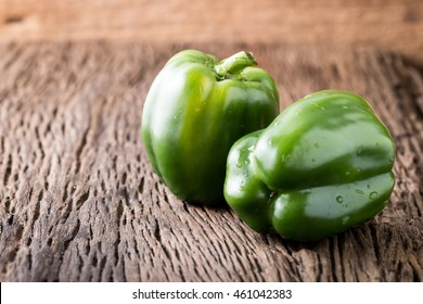 green bell pepper on wooden background