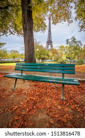 Green bench in Autumn with the Eiffel Tower in the background in Paris France