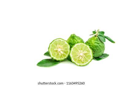 Green bergamots sliced on white background. Bergamot oil is a mixture of shampoo for anti-gray hair.