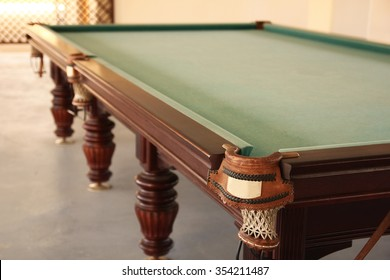 a green billiard table