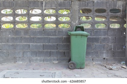 Green bins are located in the park