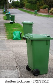 Green bins in the street on recycling day