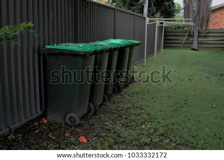 Backyard Bins green bins yard organics bins wheels stock photo (edit now