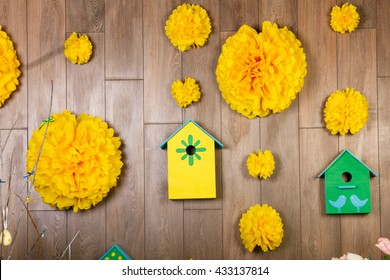 green birdhouses  and yellow pom poms, paper flower decorated