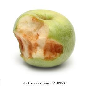 green bitten apple on white background