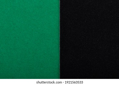 Green and black corduroy paper, velvet, cardboard. Colored background with copy space.