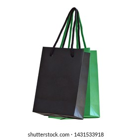 Green and black hanging paper shopping bags on white. Bottom view, isolated on white