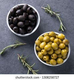 Green and Black olives in a bowl. Marinated olives. Top view.