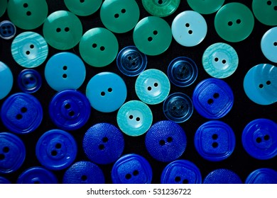 green and blue buttons on black background