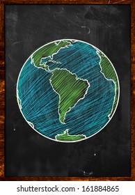 Green blue Earth on Blackboard - Globe background