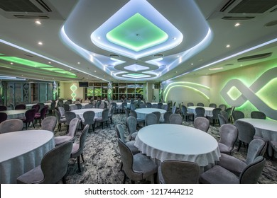 Green and blue embedded lights in restaurant interior